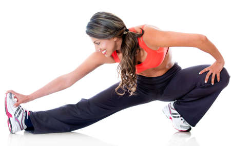 Fit woman stretching - isolated over a white background  photo