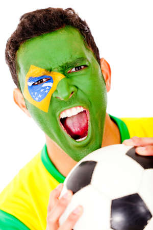 Brazilian football fan with flag painted on his face - isolated  Stock Photo - 13178718