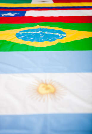 Close up picture of different Latin American flags  photo