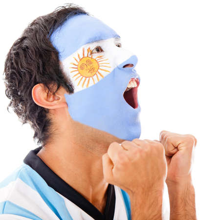Argentinean man shouting a goal - isolated over a white background photo
