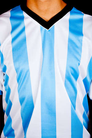 Man wearing an Argentinean shirt with stripes  photo
