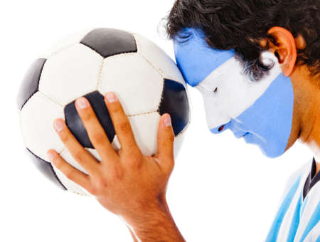 Argentinean football fan with flag painted on his face � isolated  photo