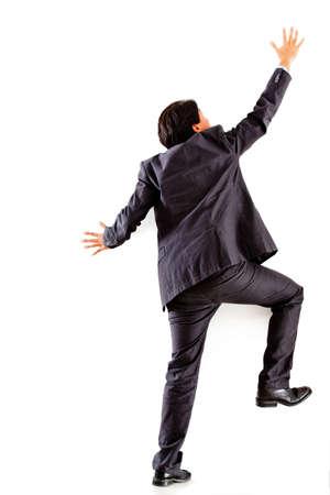 mászó: Üzletember mászó fal - elszigetelt, mint egy fehér háttér