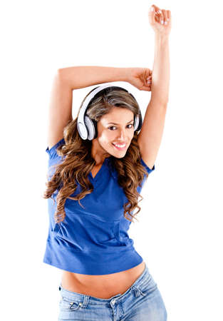 Beautiful woman listening to music - isolated over a white background  photo