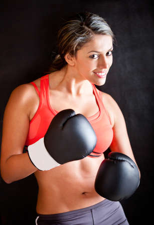 Beautiful fit woman boxing and wearing gloves  photo