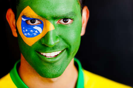 Patriotic man from Brazil with flag painted on his face  photo