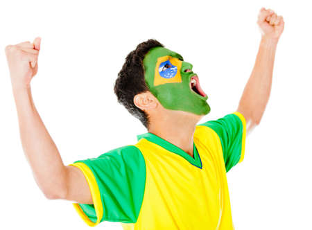 Excited Brazilian man with arms up celebrating - isolated over white  photo