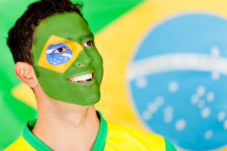 Proud Brazilian man with flag painted on his face  photo