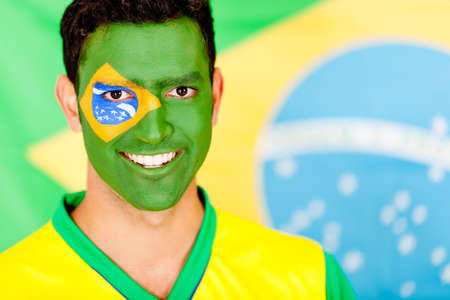 Portrait of a Brazilian man smiling with face painted  photo