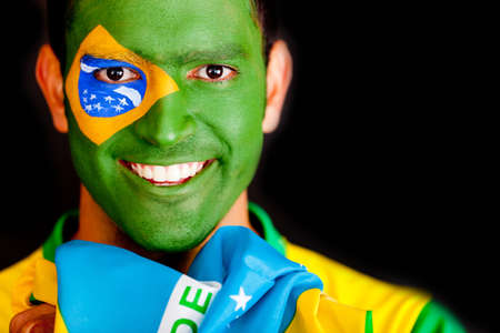 nationalistic: Brazilian man smiling - isolated over a black background