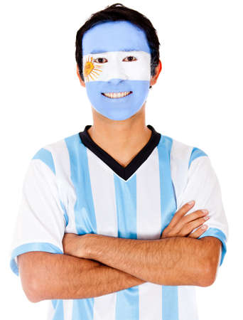 Happy Argentinean man with flag painted on his face - isolated  photo