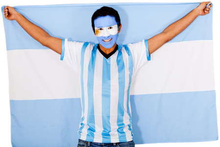 Happy Argentinean man smiling and holding the flag  photo