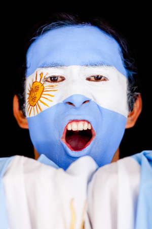 Argentinean man shouting - isolated over a black background photo