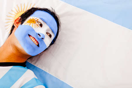 argentina flag: Portrait of a happy Argentinean man smiling