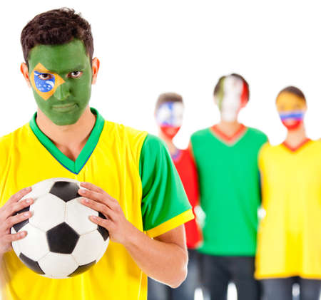 Brazilian football fan with a group of Latinamerican people  photo