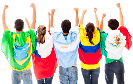 brazilian flag: Happy Latinamerican group with arms up ad flags - isolated over a white background