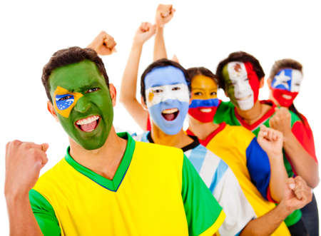 fans: Latinamerican team with arms up - isolated over a white background  Stock Photo