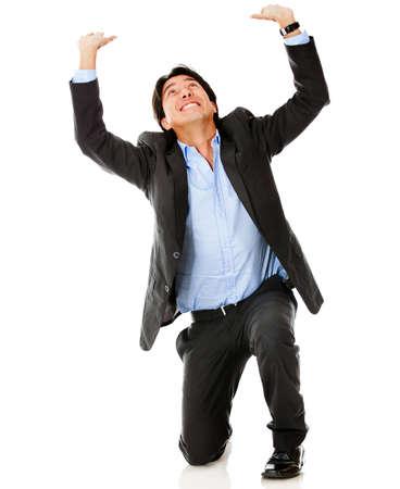 lifting: Zakenman tillen iets denkbeeldige - geà ¯ soleerd op een witte achtergrond Stockfoto