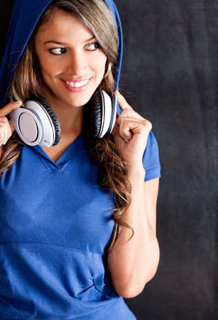 Hip-hop style woman with headphones and a hoodie  photo