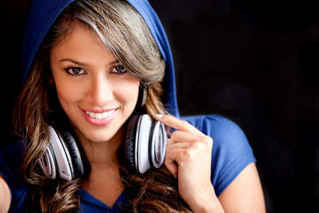 Beautiful girl with headphones and wearing a hoddie  photo