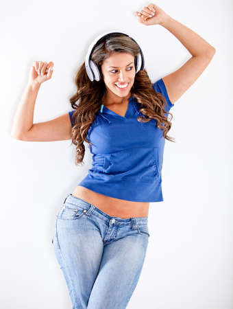 ove: Happy woman with headphones listening to music - isolated ove white  Stock Photo
