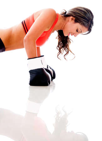 woman boxing gloves: Woman working out doing push ups - isolated over a white background