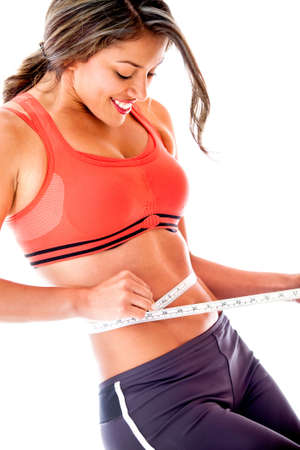 measure waist: Woman measuring her body - weight loss concepts  Stock Photo