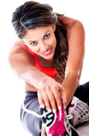 woman sport: Fit woman stretching her leg - isolated over a white background  Stock Photo