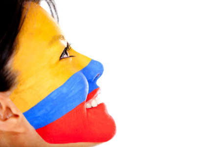 Woman with the flag Colombia painted on her face - isolated over a white background photo
