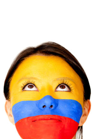 colombian flag: Colombian woman looking up - isolated over a white background  Stock Photo