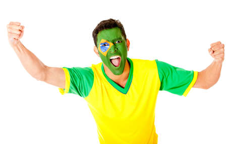 Brazilian man celebrating with arms up - isolated over a white background  photo