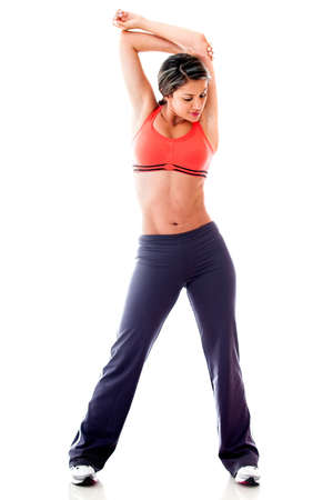 Fit woman stretching her arm - isolated over white  photo