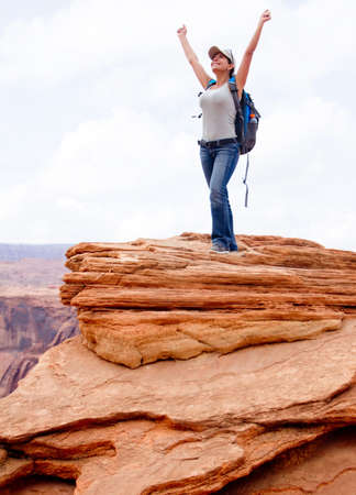Happy woman at the Grand Canyon with arms up  photo