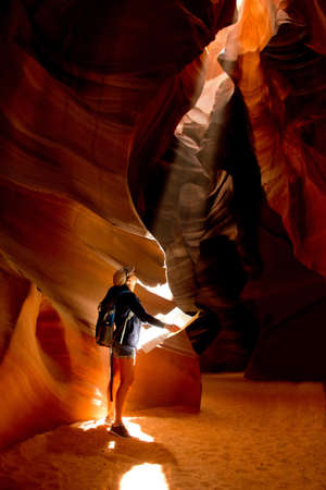 cave exploring: Woman exploring inside a cave at the Grand Canyon