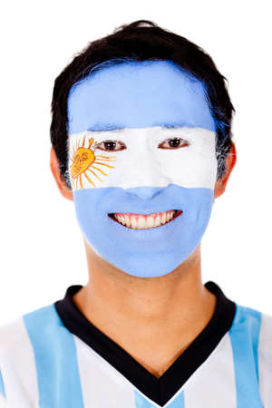 Happy Argentinean man with the flag painted on his face - isolated  photo