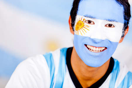 Portrait of an Argentinean man with the flag painted on his face  photo