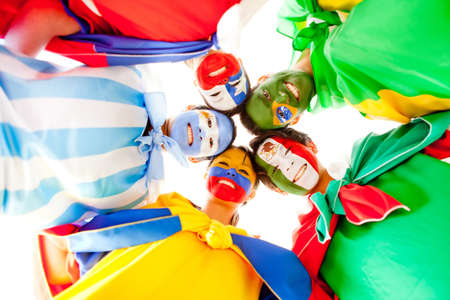 latin america: Group of Latin people with flags painted on their face