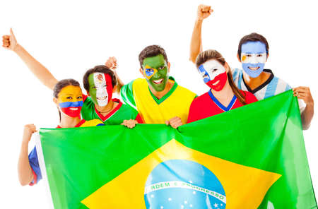 Happy Latin group holding the Brazilian flag - isolated over white  photo