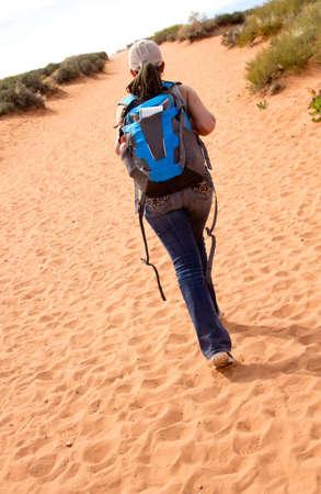 adventurous: Adventurous woman walking at the desert  Stock Photo