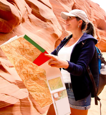 disoriented: Female explorer at the Gran Canyon and holding a map  Stock Photo