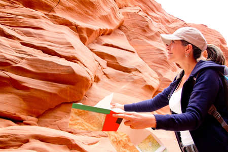 Female tourist at the Grand Canyon holding a map  Stock Photo - 13287345