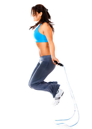 jump rope: Woman jumping rope - isolated over a white background
