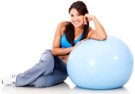 Beautiful sporty woman with a Swiss ball - isolated over white  photo