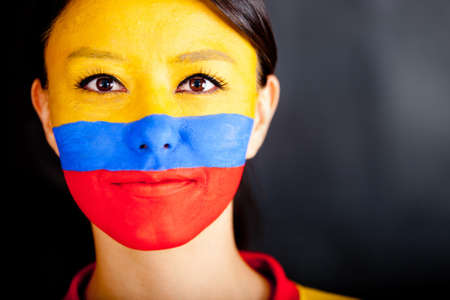 colombian flag: Portrait of a Colombian woman with the flag painted on her face