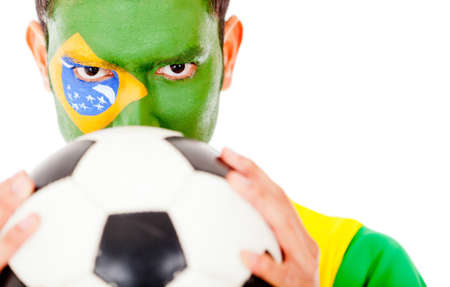 Brazilian football fan holding a ball - isolated over a hwite background  photo