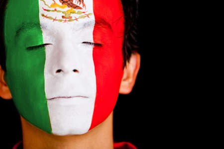 body paint: Man with the flag of Mexico painted on his face