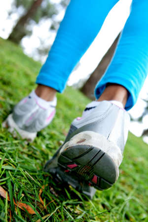 training shoes: Fit woman walking outdoors - close up on the step  Stock Photo