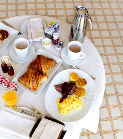 bed and breakfast: Healthy breakfast in bed served in a tray  Stock Photo