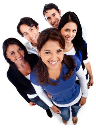 adultos: Grupo de j�venes sonrientes - aislados en un fondo blanco Foto de archivo
