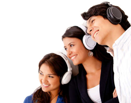 Group listening to music with headphones - isolated over a white background  photo